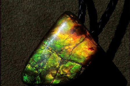Ammolite gemstone: meaning, properties, uses, power, jewelry, photo